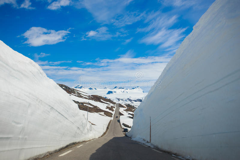Snow walls around a mountain road. At the Norway royalty free stock image