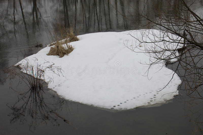 Snow on the water as a heart royalty free stock photos