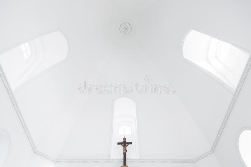 The snow-white clean well-lit dome of the Orthodox church with the windows and the crucifixion of Jesus.  royalty free stock images