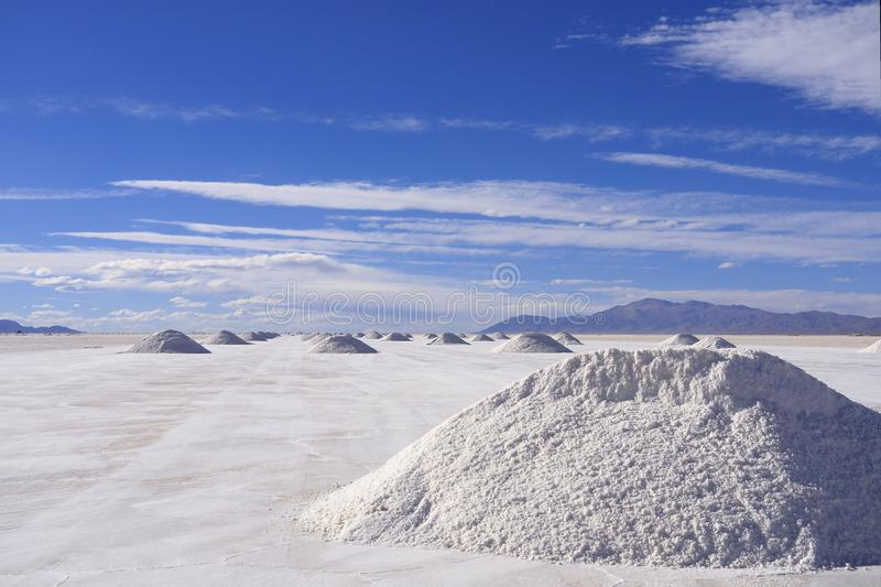 A pile of salt, blue sky and scenic clouds royalty free stock photos
