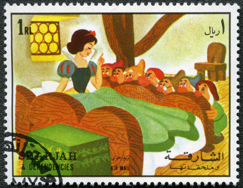 Snow White and seven dwarfs, 1972. SHARJAH & DEPENDENCIES - CIRCA 1972: A stamp printed by Sharjah & Dependencies devoted fifty years of Walt Disney cartoon royalty free illustration