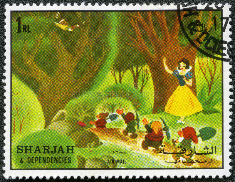 Snow White and the seven dwarfs, 1972. SHARJAH & DEPENDENCIES - CIRCA 1972: A stamp printed by Sharjah & Dependencies devoted fifty years of Walt Disney cartoon stock illustration