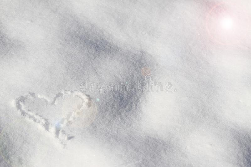 Snow. White snow. Heart on the white snow. Winter background. stock photography