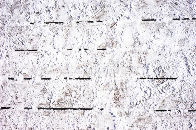 Snow on a wooden floor stock image