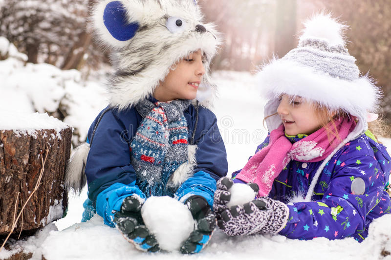 Snowball players. Young children playing in snow royalty free stock photo
