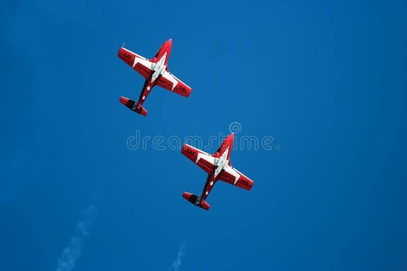 Snowbird Stunt Planes. Stunt plane doing a manuver against a bright blue sky stock photos