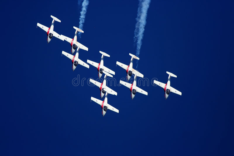 Snowbird Stunt Planes. Stunt plane doing a manuver against a bright blue sky royalty free stock photos