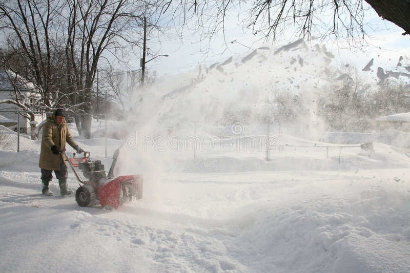 Snowblower in action stock photos