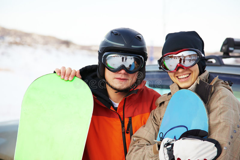 Snowboard couple on ski resort. Snowboard couple on mountain ski resort stock photos