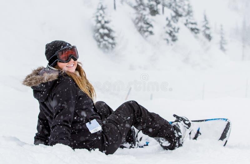 Snowboard de la muchacha foto de archivo