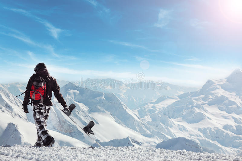 Snowboard freerider in the mountains royalty free stock photo