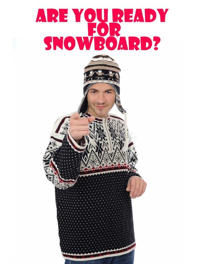 Snowboard. Uomo divertente di inverno in cappello caldo immagini stock
