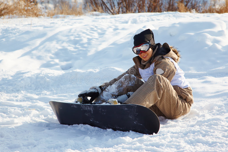 Snowboard woman. On mountain ski resort royalty free stock photography