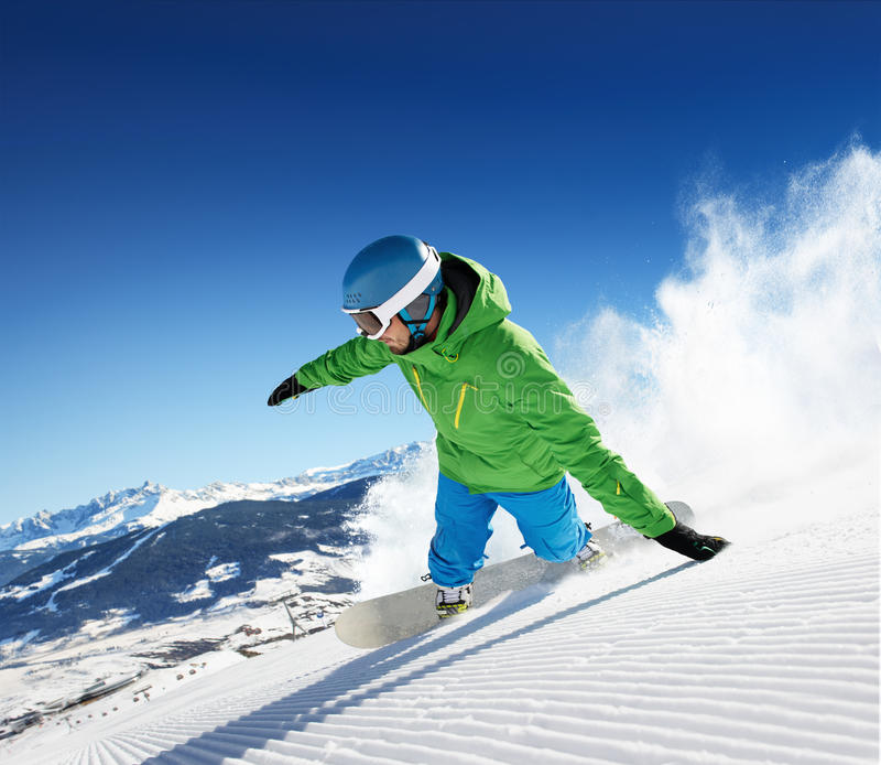Snowboarder στα υψηλά βουνά στοκ φωτογραφία με δικαίωμα ελεύθερης χρήσης