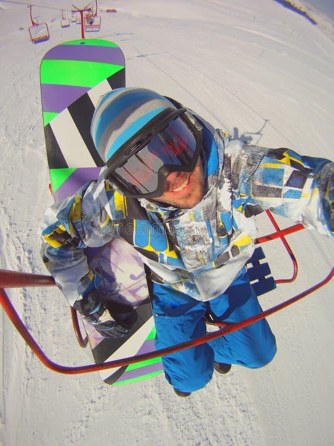 Snowboarder στο μόνος-πορτρέτο τελεφερίκ στοκ φωτογραφία με δικαίωμα ελεύθερης χρήσης