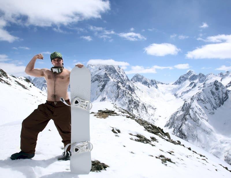 Snowboarder в горах Кавказ стоковое фото rf