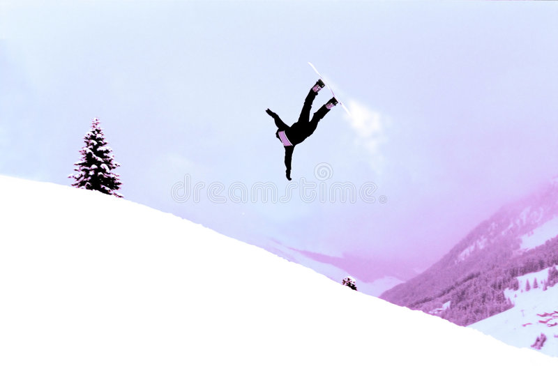 Snowboarder in action. Snowboarder riding hard. Shot manipulated digitally. Film grain visible stock images