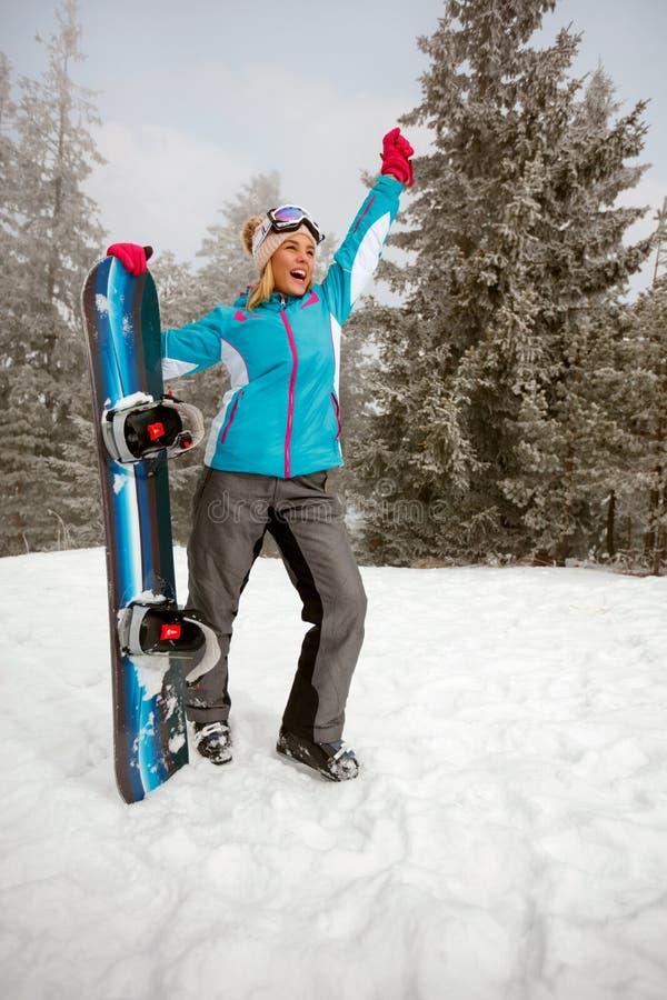 Snowboarder alegre de la chica joven imagen de archivo libre de regalías
