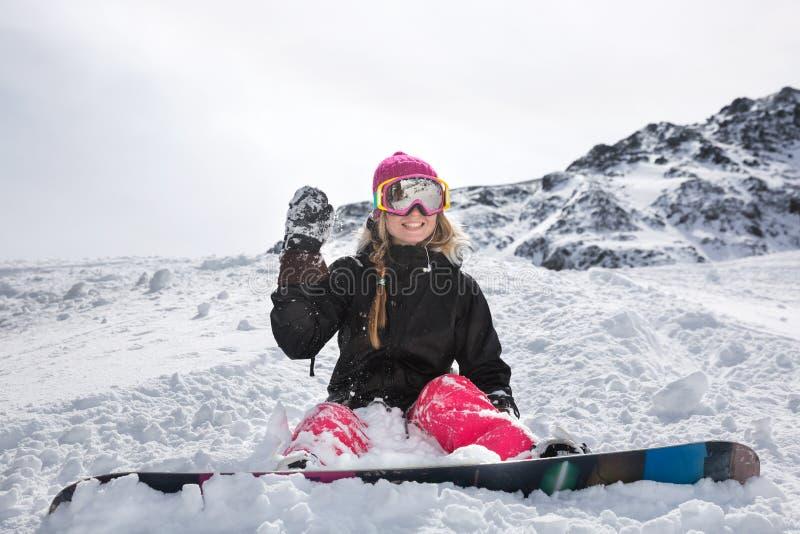 Snowboarder alegre de la mujer joven imagen de archivo
