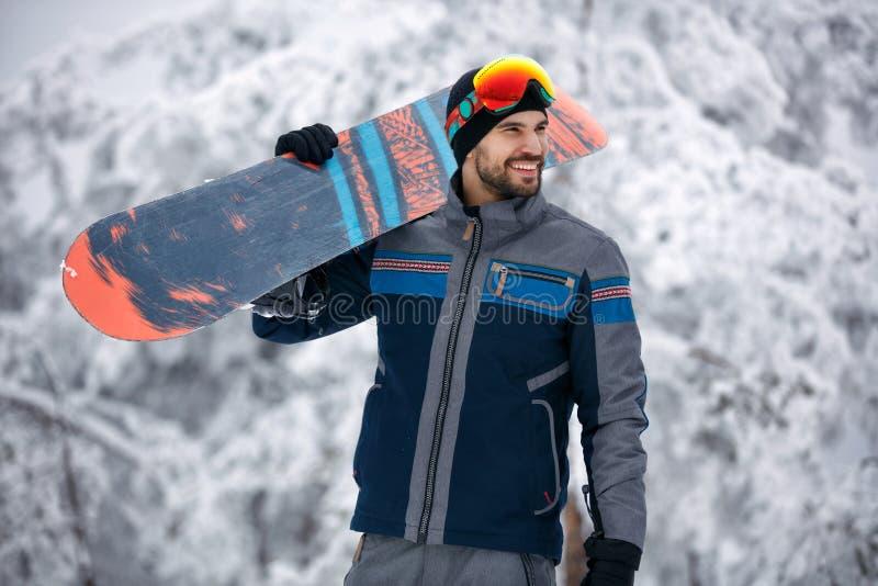 Snowboarder - concepto de la forma de vida del deporte de invierno imagen de archivo libre de regalías