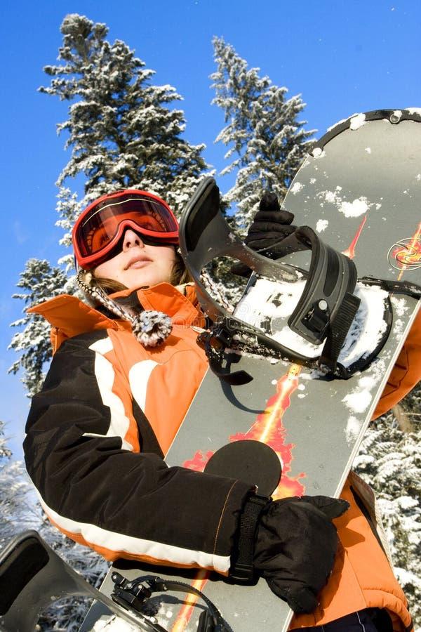 Snowboarder da mulher nova fotos de stock