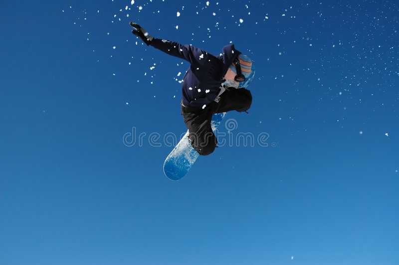 Snowboarder de vol photo stock
