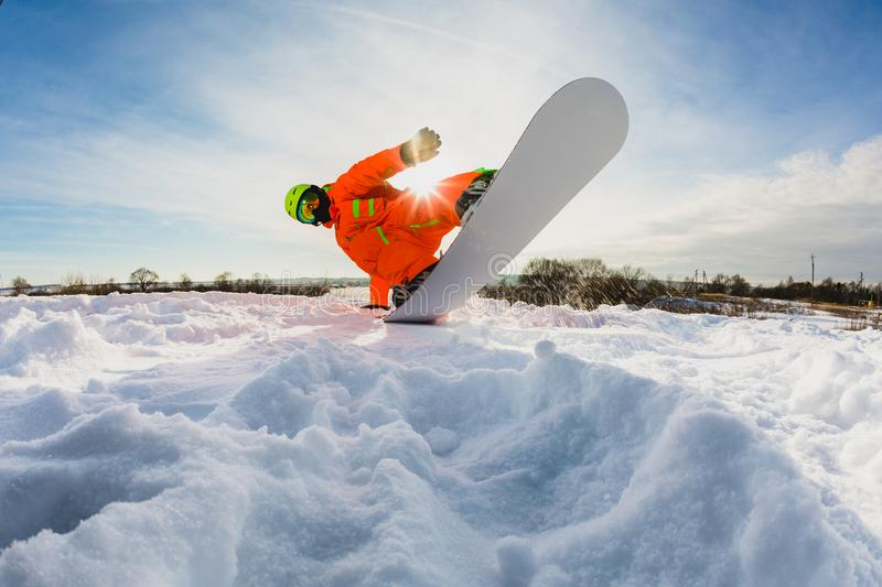 Snowboarder doing a trick on the ski slope royalty free stock photo