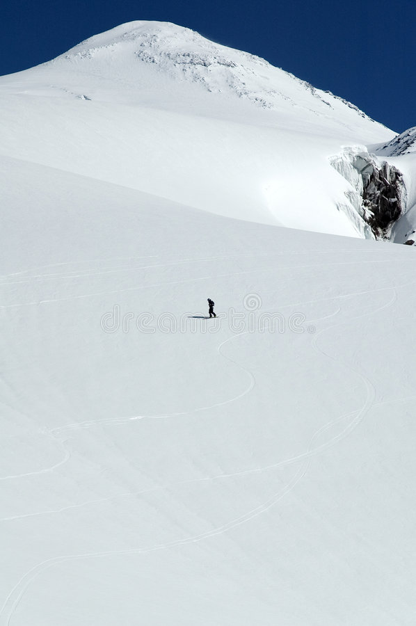 Snowboarder on Elbrus slope royalty free stock photography