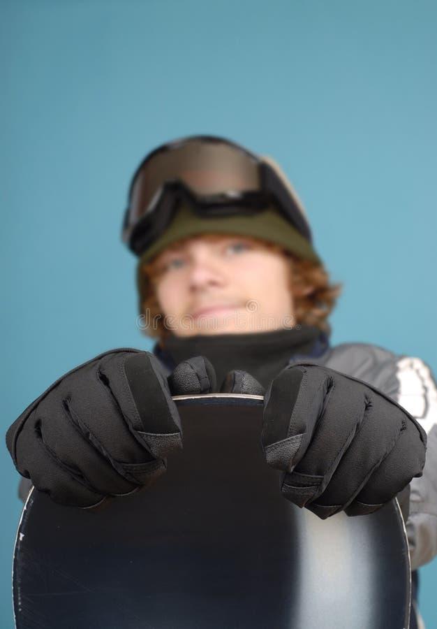 Snowboarder en zijn toestel stock foto's