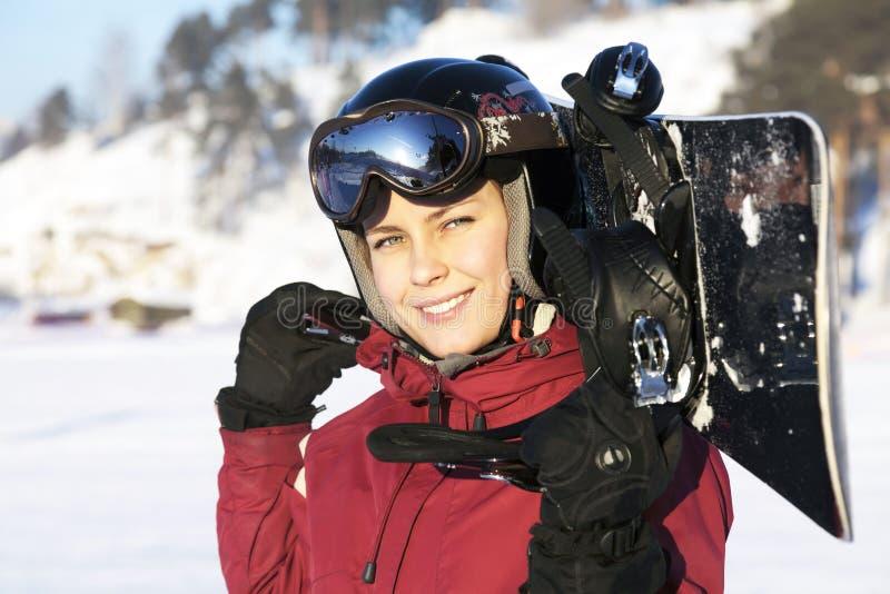 Snowboarder féminin photographie stock libre de droits