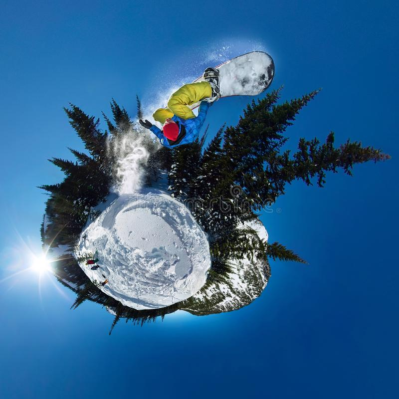 Snowboarder freerider jumping from snow ramp. Spherical 360 panorama little planet stock photo