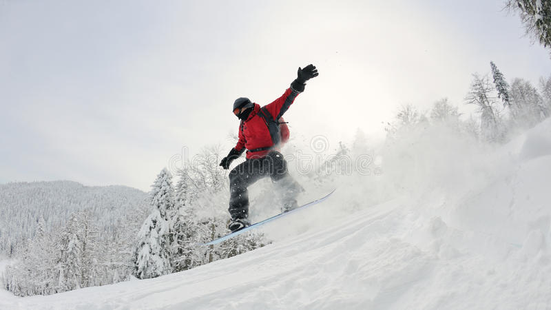 Download Snowboarder On Fresh Deep Snow Stock Photo - Image of dangerous, powder: 23796940