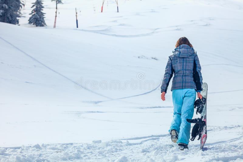 Snowboarder girl stock images
