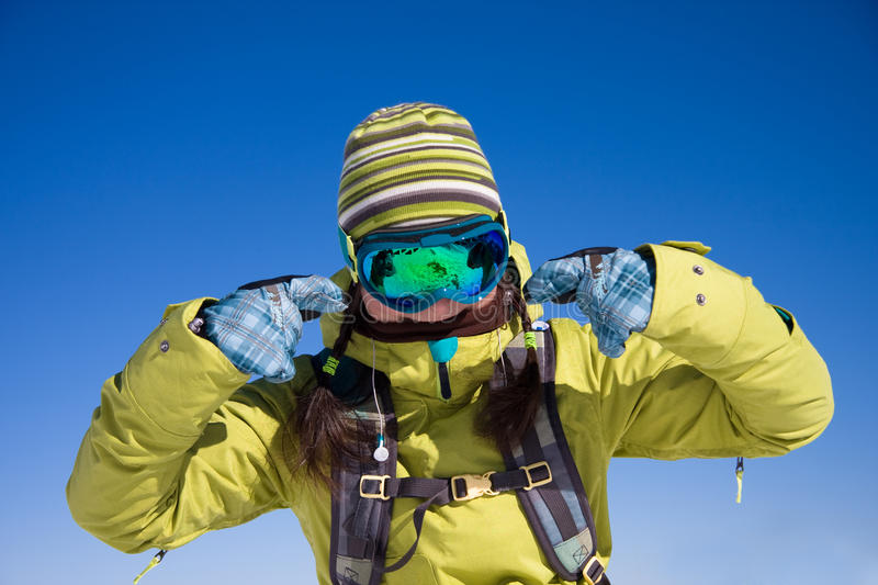 Snowboarder girl in bright clothes