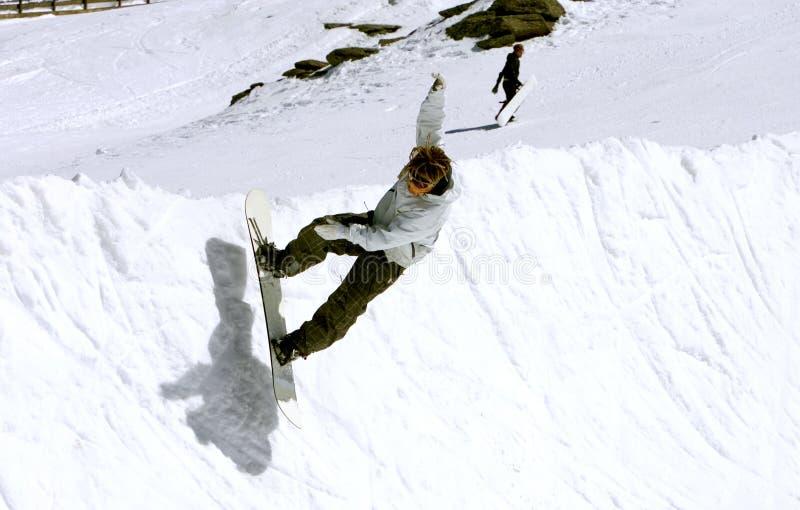 Snowboarder on half pipe of Pradollano ski resort in Spain stock image