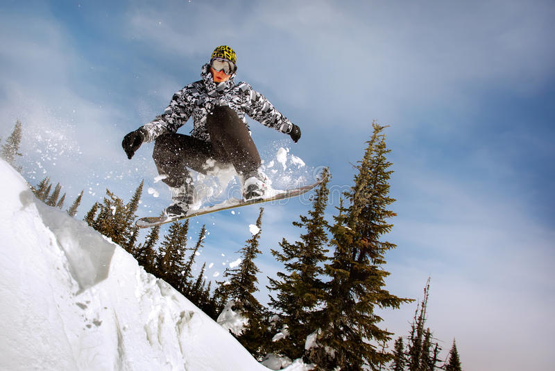 Snowboarder het springen royalty-vrije stock foto's