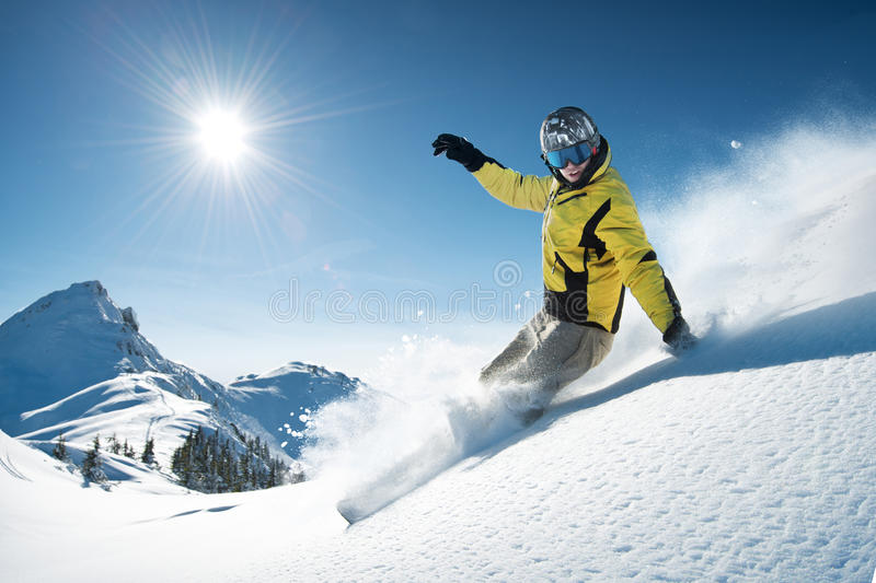 Snowboarder in high mountain