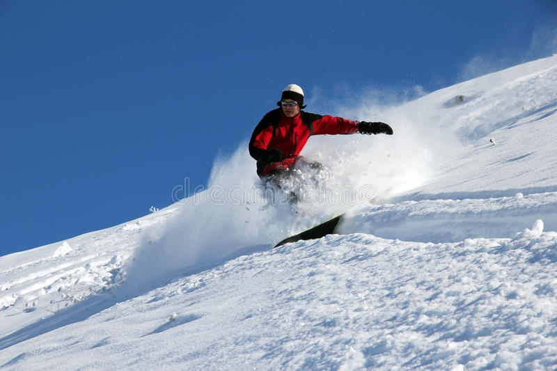 Snowboarder on the hill royalty free stock images