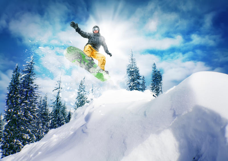 Snowboarder jump. Against sky and trees royalty free stock images