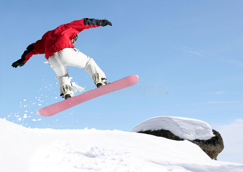 Snowboarder jumping stock images