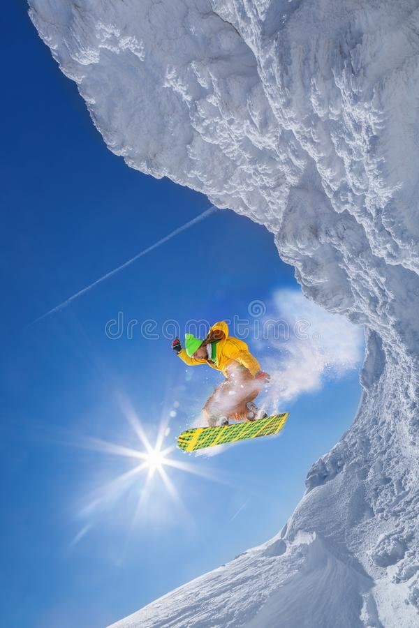 Snowboarder jumping against blue sky royalty free stock image