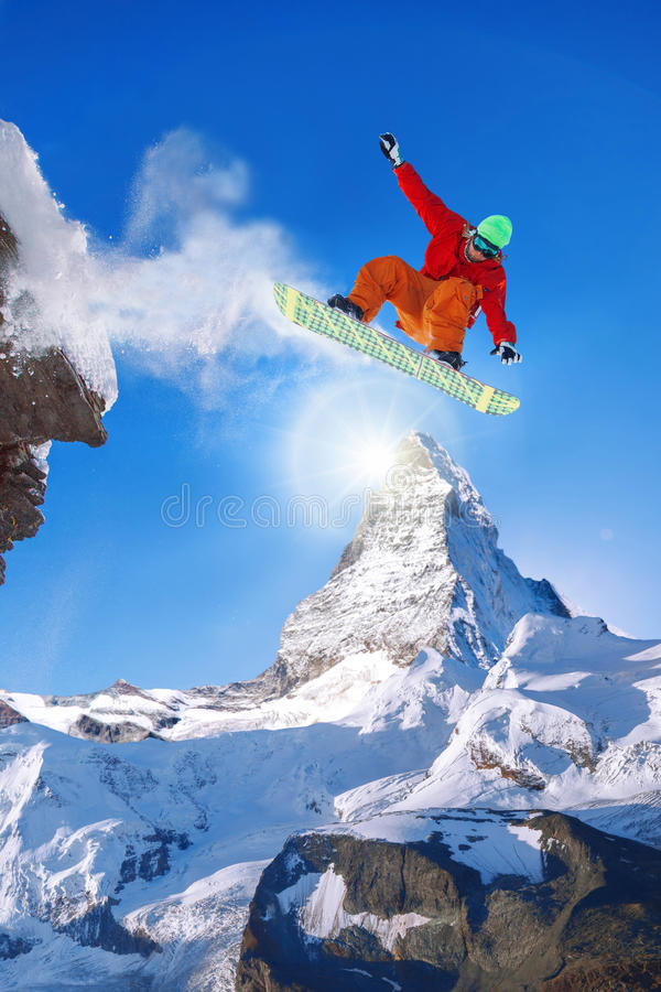 Snowboarder jumping against Matterhorn peak in Switzerland stock image