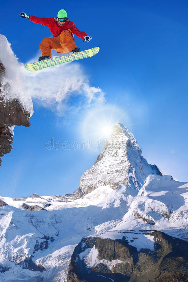 Snowboarder jumping against Matterhorn peak in Switzerland stock image