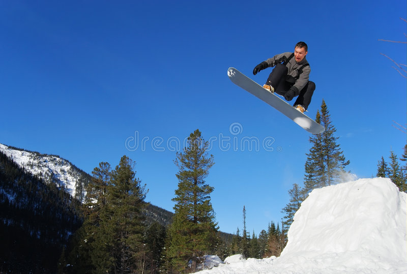Snowboarder jumping high royalty free stock images