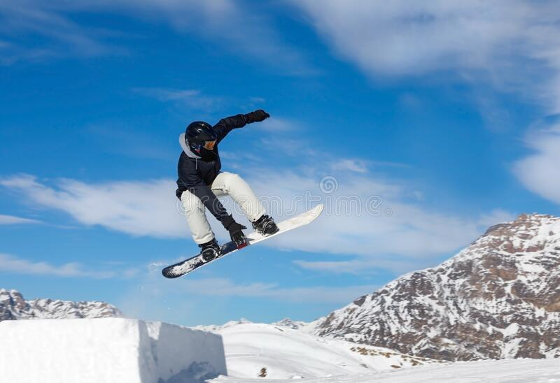 Snowboarder jumps in air stock photos