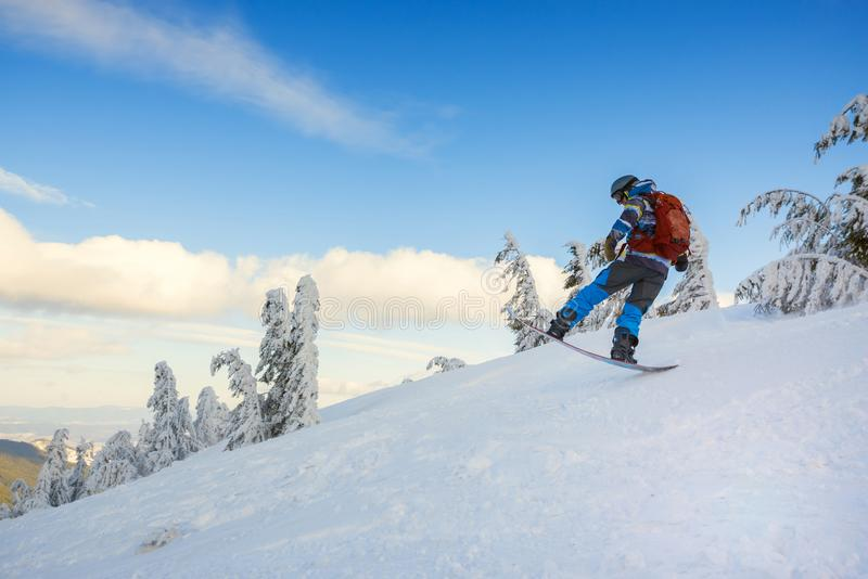 Snowboarder jumps on the background of blue sky royalty free stock image