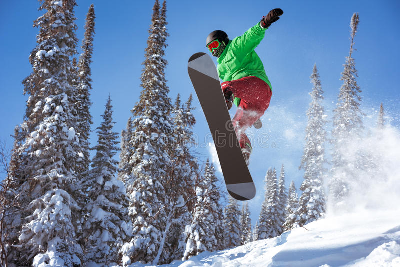 Snowboarder jumps freeride powder forest royalty free stock image