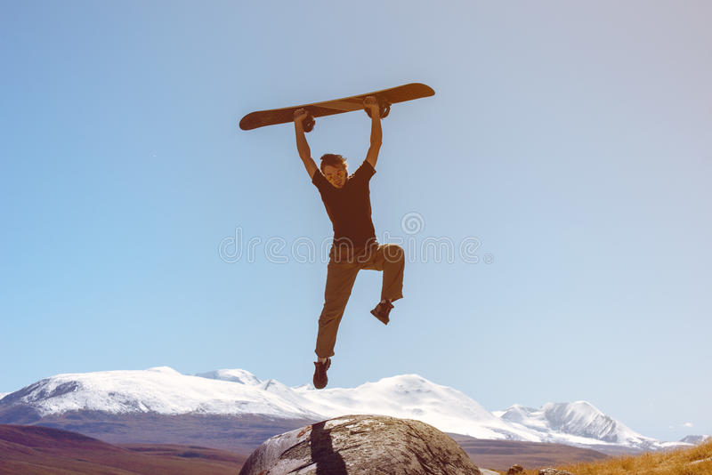 Snowboarder jumps on mountains backdrop skiing royalty free stock photos