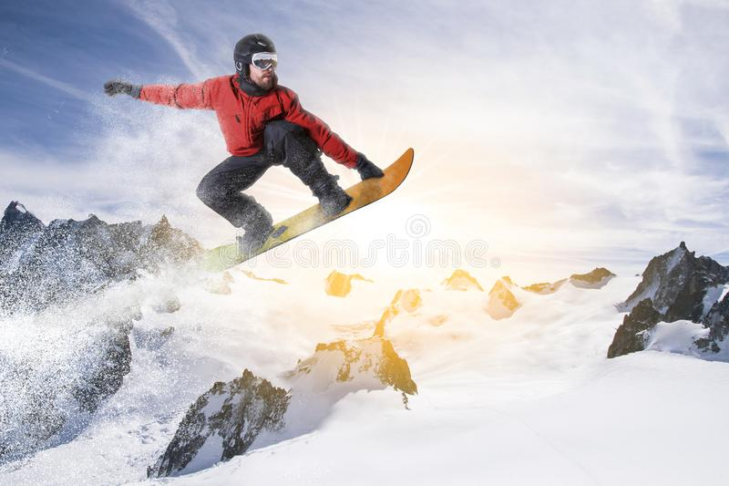 Snowboarder jumps on snowboard in a snowy winter landscape royalty free stock photography