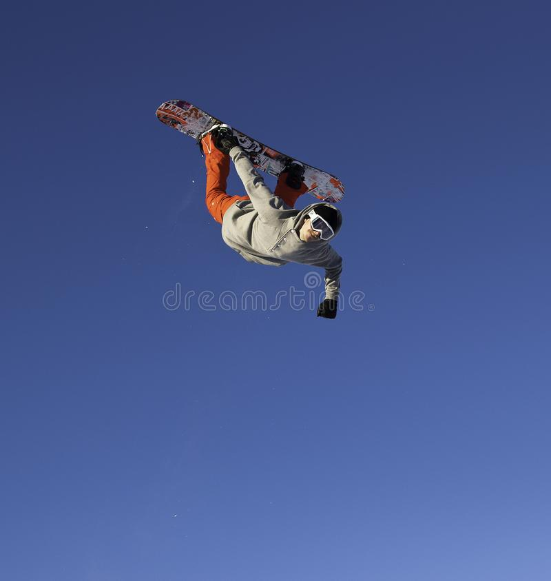 Snowboarder in lucht stock foto